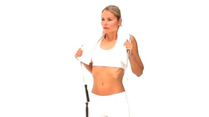 Cute blonde woman with a jump rope