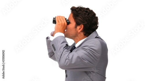 Young business man with binoculars
