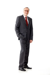 Casual senior business man standing on white background