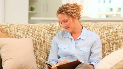 Relaxed woman looking at an album