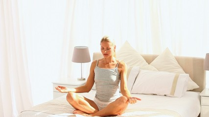 Blonde woman meditating