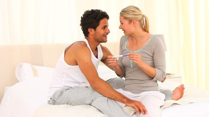 Young couple with a positive pregnancy test