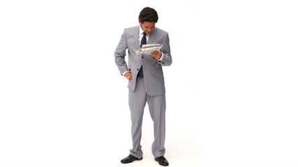 Elegant businessman doing crosswords