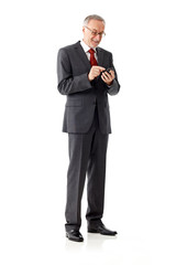 Mature business man with smartphone