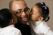 Girls Kissing Daddy On The Cheek