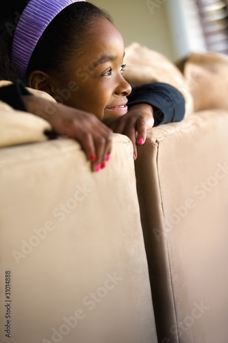 Girl Looking Over The Back Of Couch