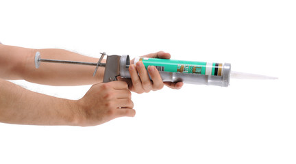 Applying silicone with caulking gun isolated on white.