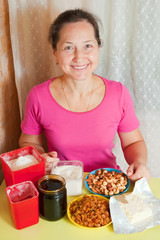 woman with food products for honey cake