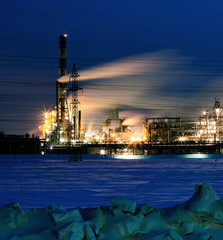 Lighted refinery  in the evening after sunset