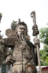 ancient Chinese warrior sculpture at Wat Pho