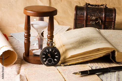 Tuinposter Retro hourglass and the book - vintage