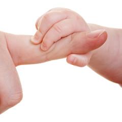 Baby greift großen Zeigefinger