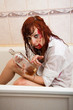 young red-haired woman in shower drinks alcohol