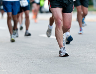 Legs of runners in matathon.