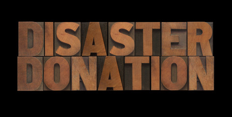 the words disaster donation in old wood type