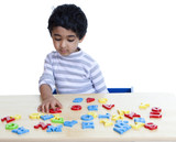 Preschooler Identifying Alphabets and Numbers poster