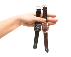 Two female wristwatches in hand isolated on white background