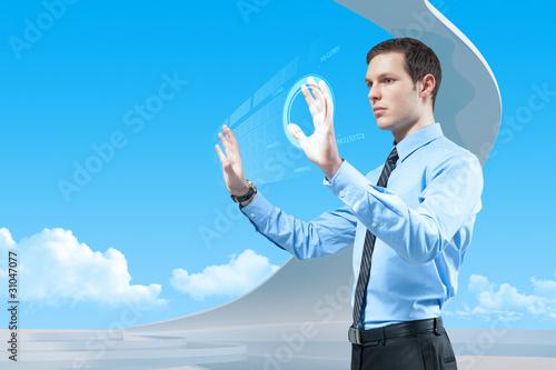 Businessman using futuristic hologram interface keyboard