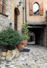 Old terraced houses on cobbled alleyway, Castell'Arquato