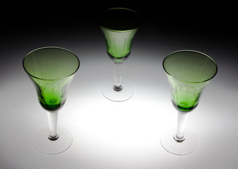 Three green glasses on black and white background