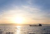 Bulk-carrier ship at sunset