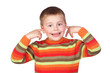 Funny child covering his ears