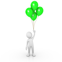 Man holding green balloons