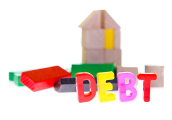 Concept of debt and credit from toy blocks