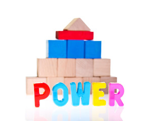 Power concept from wooden toy blocks