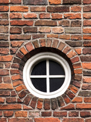 old wall and round window