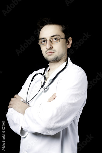 Doctor posing on black background