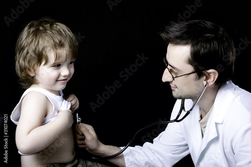 doctor measuring pulse to a child