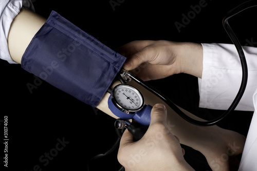 Doctor is measuring the pulse