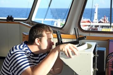 navigator on bridge of ship