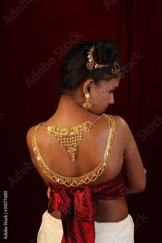 girl with gold ornaments on nude back