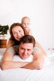 Lovely family in bed
