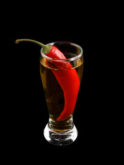 Cocktail with chilli pepper isolated on black