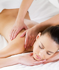 Massage on shoulder for woman