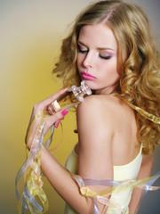 beautiful woman with perfume bottle