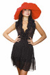 beautiful young woman in black dress and red hat