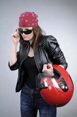 cool girl posing with sunglasses and red helmet