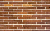 Wall texture for background with brown-orange bricks