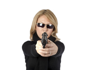 Blond lady aiming with pistol