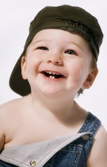 Head And Shoulders Portrait Of A Boy Laughing