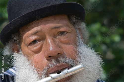 Elderly African American Man Playing Flute