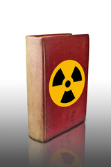 Radioactive sign on old book