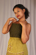 model displaying green strapless top and midi