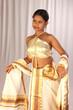 model displaying kerala kasavu mundu,strapless blouse