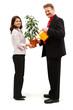 Happy couple watering plant