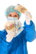 female surgeon holding banknotes